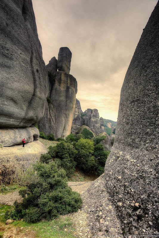 man in rock formation meteora greece - scaled
