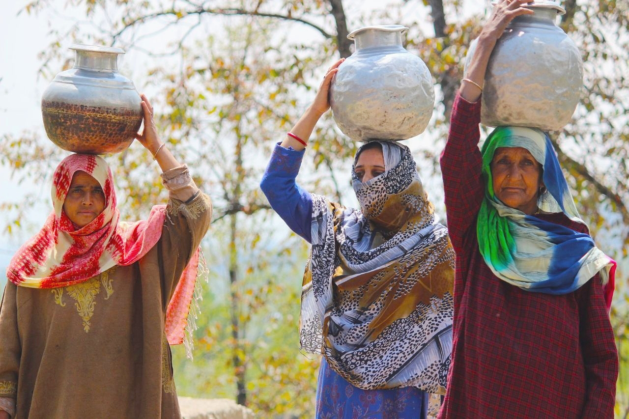 Ladies carrying water in vessels on their head amid shortage of water in their area.