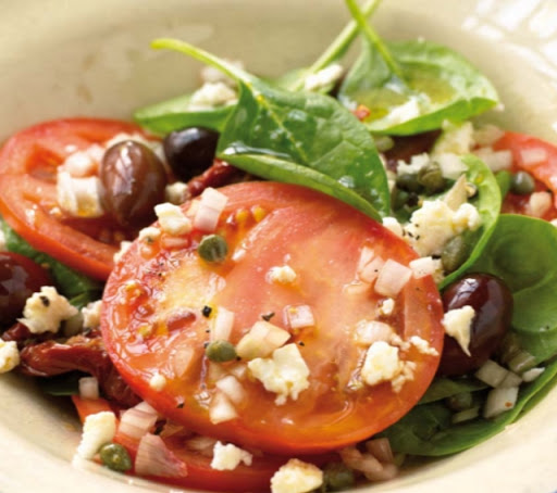 Melted feta on tomatoes and spinach