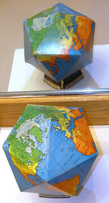 Cardboard folded up dymaxion globe using Fuller Projection 1967