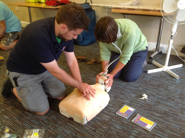 Crew Members Suzie and Chris carrying out CPR and assisted breathing on a child manikin on a Casualty Care Course - July 2014 Photo: Dave Riley