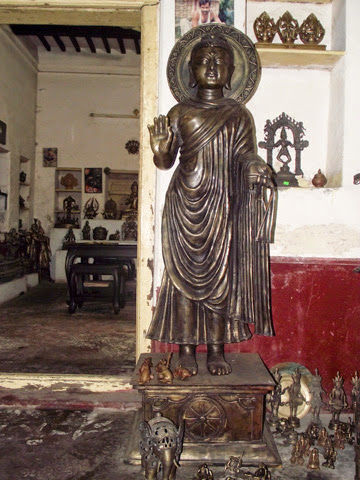 Budha statue of brass in metal crafts workshop at Dhamrai