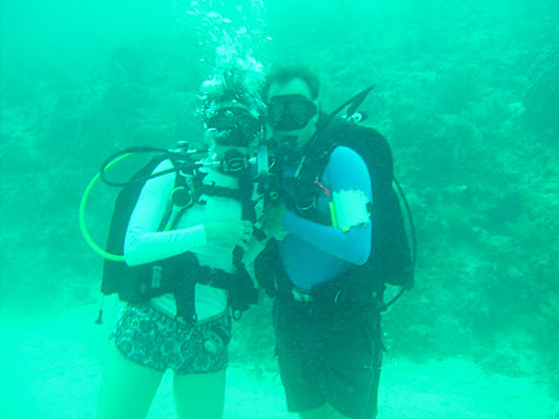 Ana and me in front of the reef near the sandy bottom of the ocean.