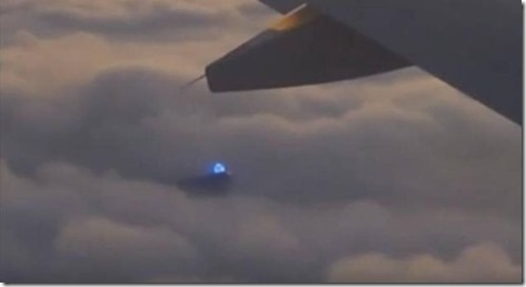 blue light ufo plane clouds