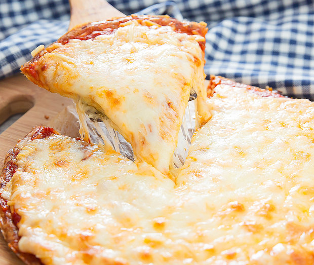 a slice of flourless cheese crust pizza