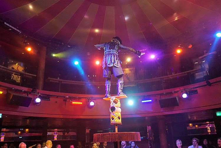 A tricky balancing act executed during the Cirque Dreams dinner show.