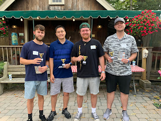 Corcoran Management Company employees with their mini trophies at Kimball Farm