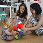 Playing with auntie, mommy, and Elmo