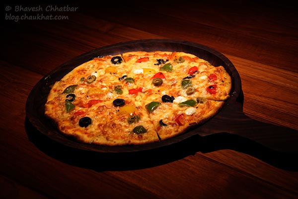 Thin-crust Global Goodness Pizza served at Toss Sports Lounge Koregaon Park