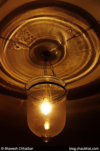 A decorative lamp with lighting effect on the roof of Savya Rasa [Koregaon Park, Pune]