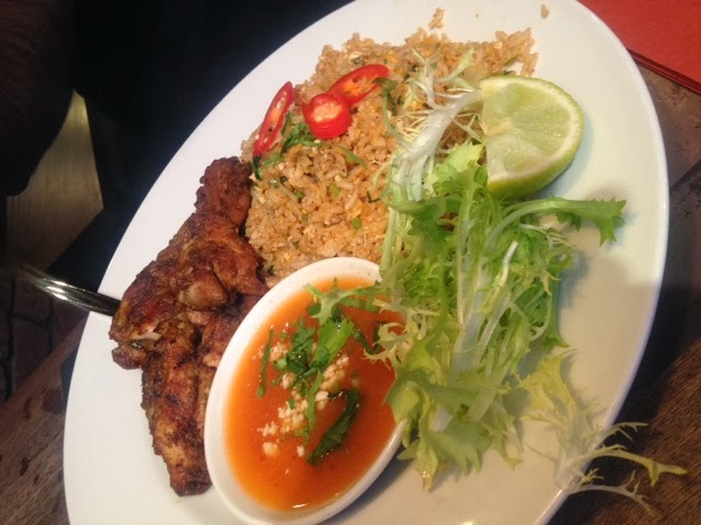 Indonesian nasi goreng, served with chicken and salad