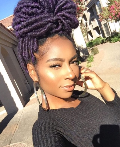 girl with purple jumbo faux locs