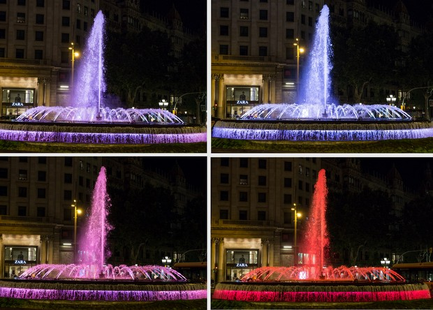 photo of the outside fountain lit up with lights
