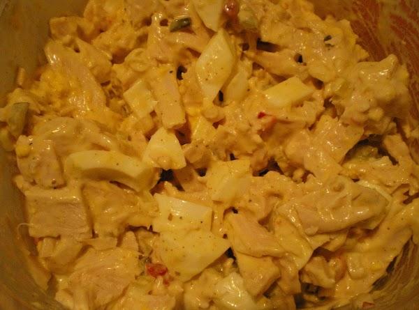 In a medium bowl combine turkey, pickles, onion, pimento, horseradish sauce, old bay season,...
