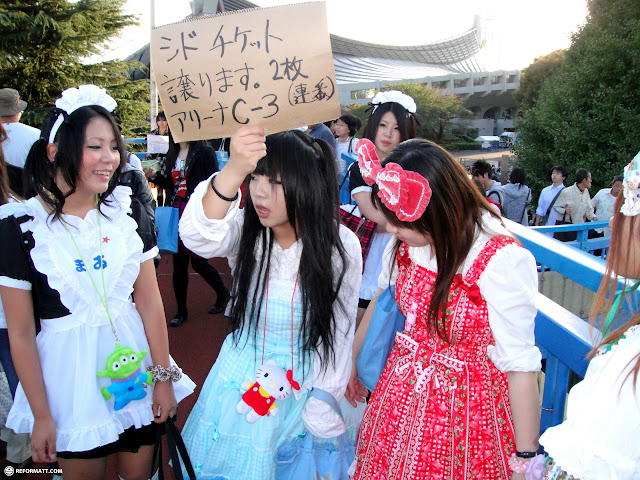 Japanese girls in need of tickets for SID at yoyogi stadium in shibuya in Shibuya, Tokyo, Japan