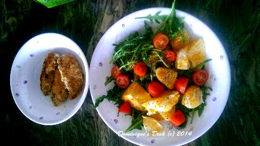 Orange salad and breaded chicken