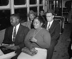 "Montgomery Bus Ride post Supreme Court's Integration Order Among the first to ride a Montgomery bus after the Supreme Court's integration order went into effect December 21, 1956, are (front row) Rev. Ralph Abernathy and an unidentified woman, and (second row) Rev. Martin Luther King, Jr., and Rev. Glenn Smiley of New York, ""who said he was in Montgomery as an observer."" (AP/Wide World Photos)"