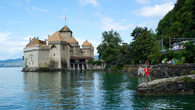 posing at Chillon Castle in Switzerland in Veytaux, Vaud, Switzerland
