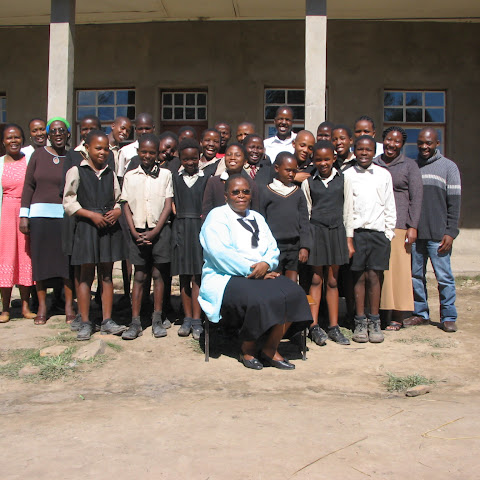 The headteacher and staff get on well with the pupils, here are some of the teachers and a few of Karabo's classmates.