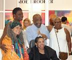 Opening for Moe Brooker exhibition at Stella Jones Gallery. Clockwise from bottom left: Sonia Sanchez, Danys Perez, Moe Brooker (artist), Vick Meek; Carole Brooker (Moe&#039;s wife)<br /> (Photos by Ellie Meek Tweedy.)