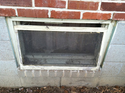 Basement window open screen brick stock photo