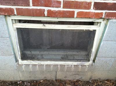 Basement window open screen brick stock photo