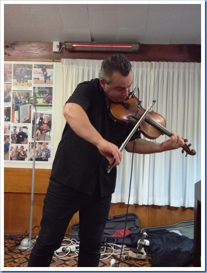 Nick Jones playing his acoustic violin as our special guest artist. Photo courtesy of Dennis Lyons.