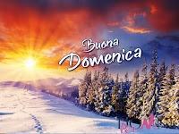 buona domenica buon giorno immagine con scritta alba tramonto neve paesaggio montagna inverno.jpg