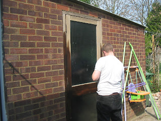 Daddy painting the Garage Door, which was the only photo of the Garage I could find!