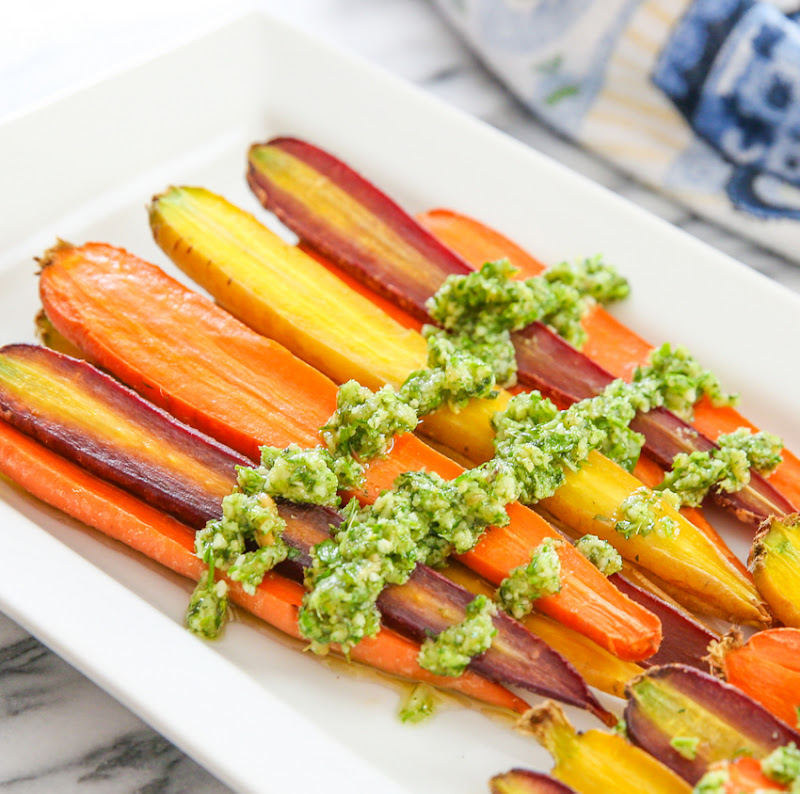 close-up photo of pesto over roasted carrots