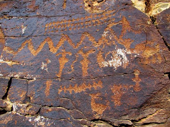 A panel of small petroglyphs