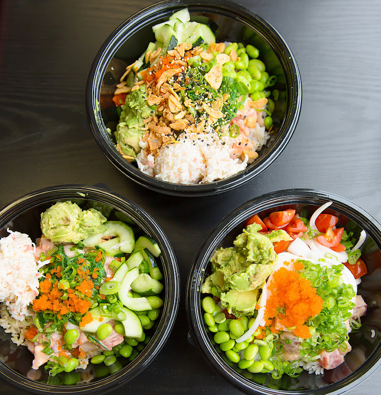 overhead photo of three different poke bowls