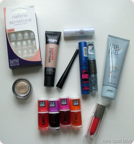 Nip and Fab Glycolic scrub, Maybelline Color Show Jelly Tints, Nailene false nails, Essence Get Big Lashes Waterproof Mascara, Maybelline Clor tattoo Creme de Nude, Maybelline color elixir in Signature Scarlet, Natural Collectiom Concealer Green, Maybelline Hyper Glossy Mascara, L'Oreal Infallible Matte in Vanilla