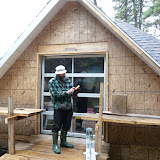 the two-story garage Raynald has almost completed at his Manicouagan camp