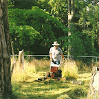 Owen Gleaves uses his gravely tractor to cut high grass at Gleaves-Clements Cemetery