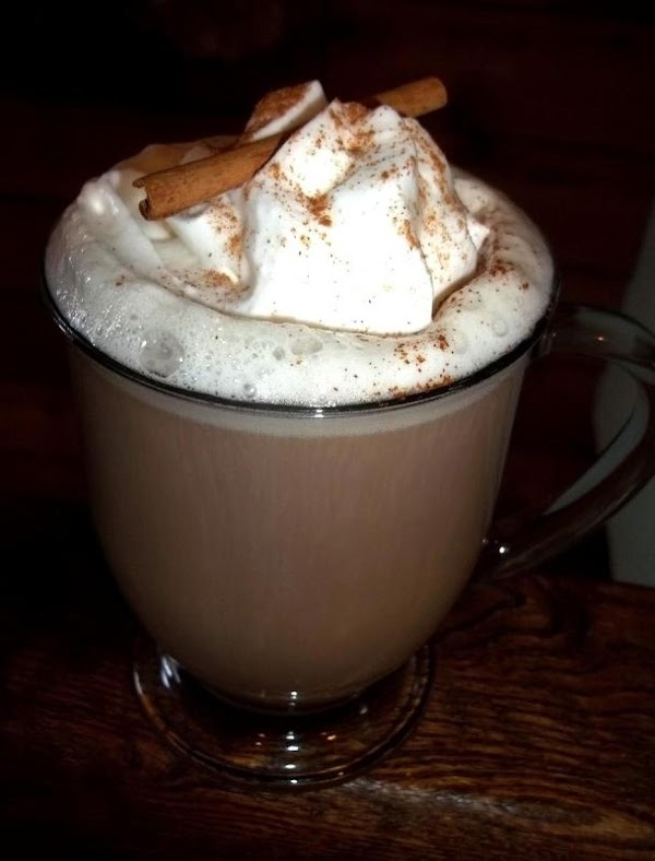Serve in preferred mug with whipped cream and a sprinkle of cinnamon.  Yum! So good!