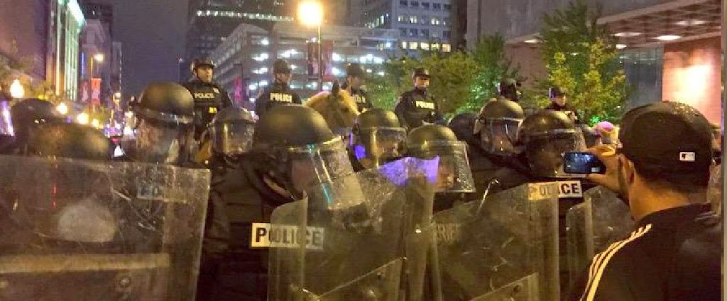 Police stand still as protest rages in Baltimore