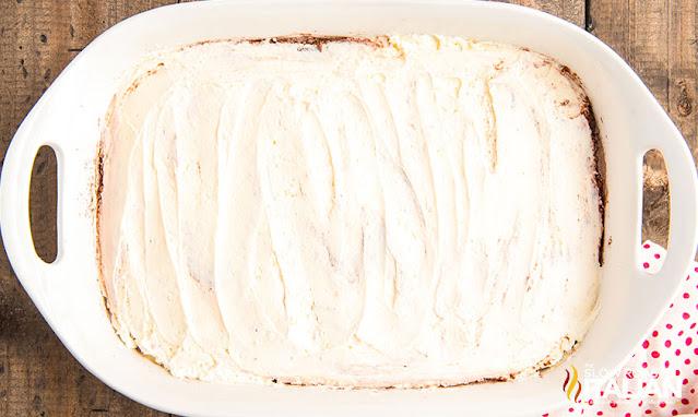 cream mixture over cake