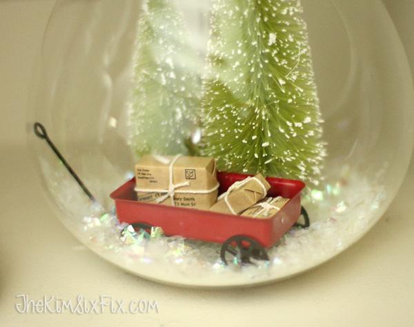 Tiny wagon filled with christmas packages