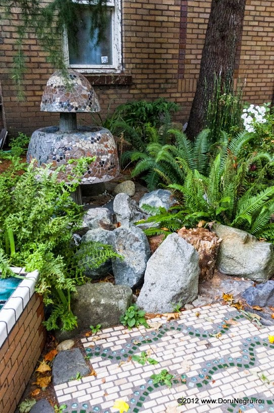 A miniature garden hidden near a building in the West End district