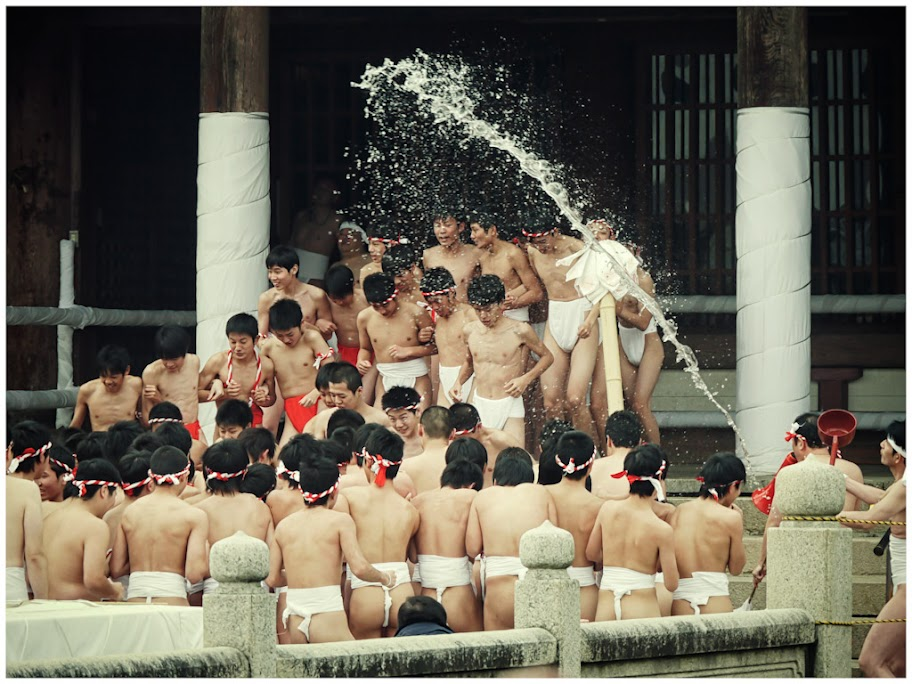 Boys getting doused with water at DoyaDoya festival
