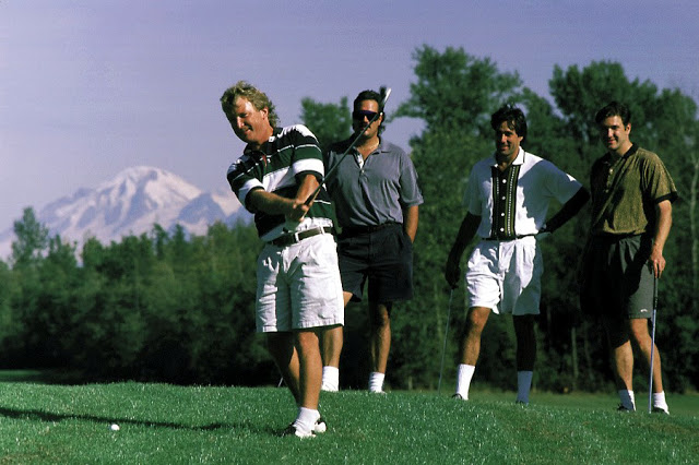 A group enjoys a first-rate game of golf on an immaculately kept green framed by the Cascade Mountains at North Bellingham Golf Course. / Credit: Jon Brunk