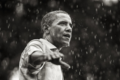 photo of President Barack Obama speaking in the rain during a campaign rally in Glen Allen, Virginia. By Brooks Kraft