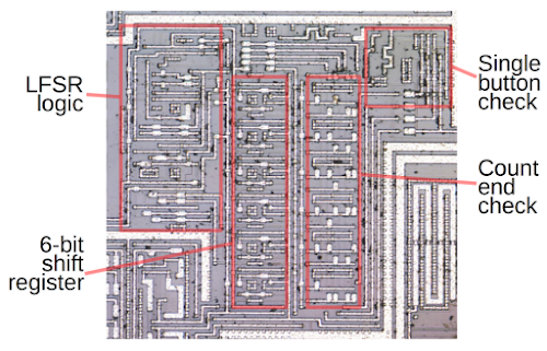 Divider circuitry for the row signal, on the lower right of the die. The input frequency is divided by a particular value depending on which of the four keyboard rows is selected. The counter is implemented with a shift register. The LFSR logic generates the new bit shifted in. The count end check circuitry controls the count length for the selected row. The single button check verifies that exactly one button is pressed.