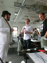 Photo: Jason Scott, coda, and Krue chatting.
