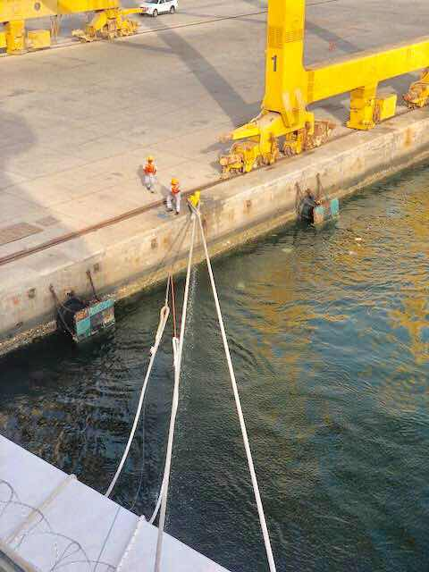 Tying mooring lines for Viking Orion in Muscat, Oman