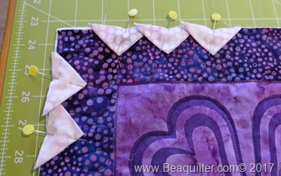 Purple batik table topper with prairie points5
