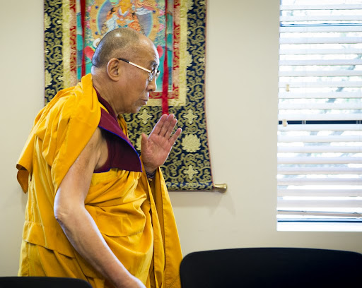 His Holiness the Dalai Lama blessing holy objects in the board room of FPMT International Office, Portland, Oregon, U.S., May 10, 2013. Photo by Leah Nash.