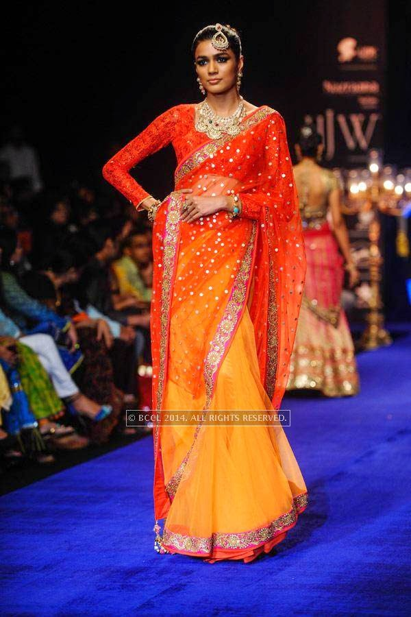 A model showcases a creation by Golecha Jewels on Day 3 of India International Jewellery Week (IIJW), 2014, held at Grand Hyatt, in Mumbai.<br /> <br /> <br /> <br /> <br />