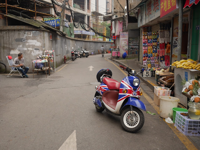 motorbike with a Union Jack design parked in an alley in Changsha